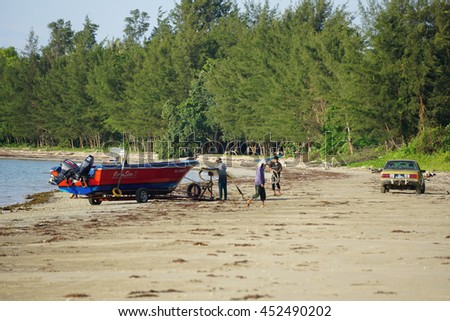 Labuan,Malaysia-July 13,2016:Labuan traditional fisherman returning from the sea after fishing activity at Labuan tropical island.Fishing is one of the main occupations of local people in Labuan.
