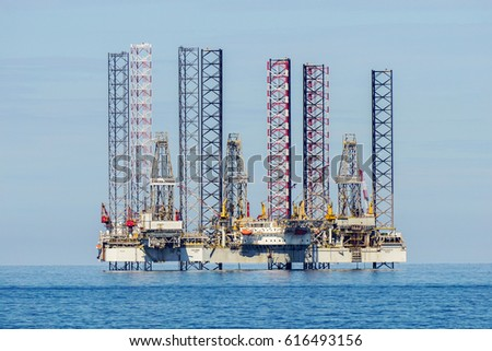 Labuan,Malaysia-Mac 25,2017:View of of the lay-up drilling jackup rigs in Labuan waters in the Brunei Bay area at Labuan island,Malaysia on 25th March 2017.