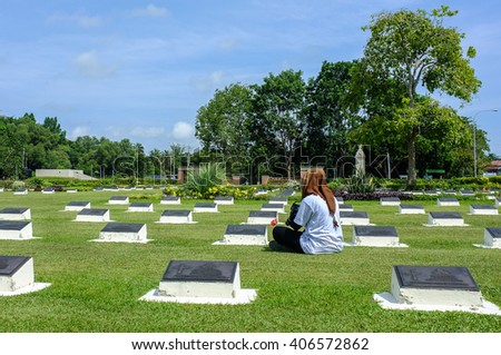 Labuan Malaysia - Oct 13, 2013 : Undentified tourist take photo at War Memorial Park in Labuan,Malaysia. Labuan once known as The Pearl of The Orient is one of the World War II allied stronghold.   - stock photo