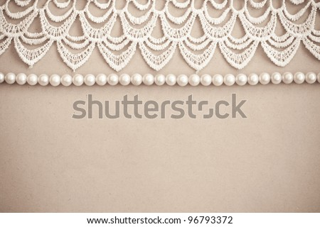 Lace and pearls vintage background - stock photo