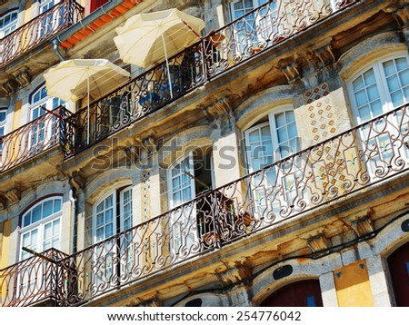 Lace balconies of old houses in Porto, Portugal. Porto is one of the most popular tourist destinations in Europe. - stock photo