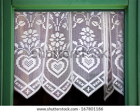 Lace curtain with a hearts, symbol of love - stock photo