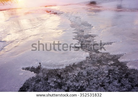 Lace ice frozen moisture admired his tenderness and subtlety. Babbling like a bell, cheerful mountain stream is clean water in the river, which give the water town at christmas - stock photo