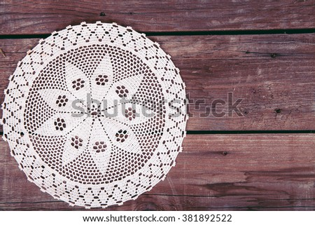 lace on wooden background  - stock photo