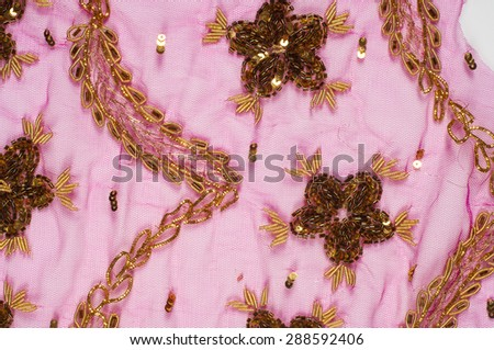 Lace pink embroidered with beads and sequins - stock photo