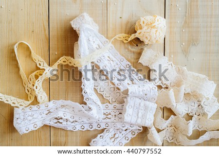 lace ribbon on wooden background, crafts concept