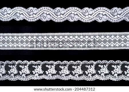 Lace trim ribbon over black background