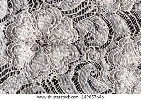 Lace with Flower Pattern on Black Background, Closeup