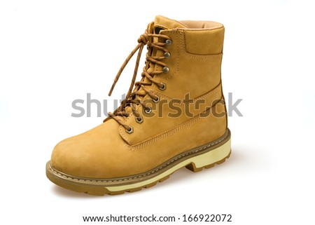 Laced yellow shoe on the white background - stock photo