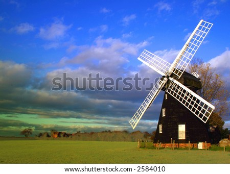 Lacey Green Windmill in the Buckinghamshire Chilterns dates from 1650 and is the oldest smock design windmill in England. Photographed early evening - stock photo