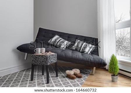 Lack of space. Sofa that didn't fit into the living room. - stock photo