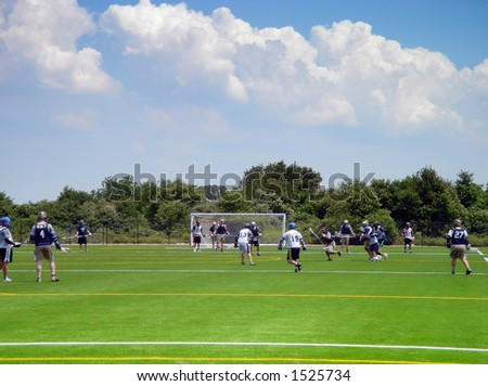 Lacrosse players in action on the Floyd Bennet field in Brooklyn, New York - stock photo