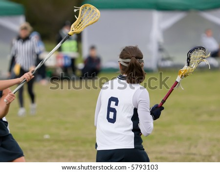 Lacrosse players on the field - stock photo