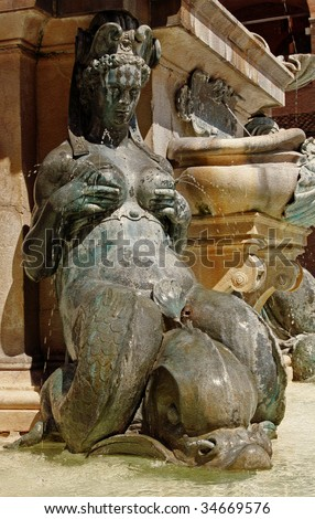 Lactating Mermaid, Neptune Fountain, Piazza Maggiore, Bologna. Sculpted by Giambologna (Jean Boulogne 1529-1608) - stock photo