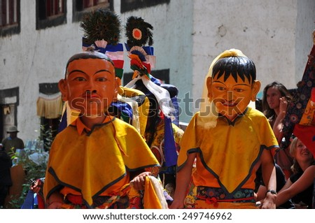 LADAKH, INDIA- Aug 09:- An unidentified buddhist monk dancing during a mask festival at Chemrey Monastery on August, 09, 2011.  Ladakh, India - stock photo