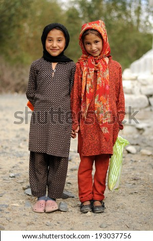 LADAKH, INDIA - AUGUST 27: Small unidentified muslim children in Ladakh Area on August 27, 2012. Education has been made free for children for 6 to 14 years of age in India. - stock photo