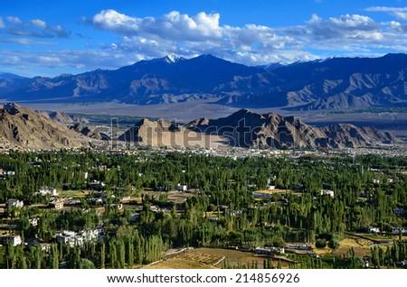 Ladakh's capital Leh and Himalaya mountains, India, view from Shanti Stupa - stock photo