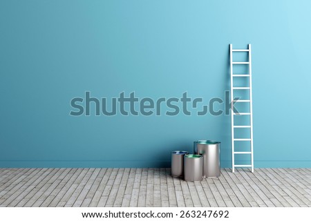 ladder and paint buckets by the wall - stock photo