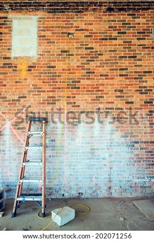 Ladder at Construction Site. Brick Wall. Construction Concept.