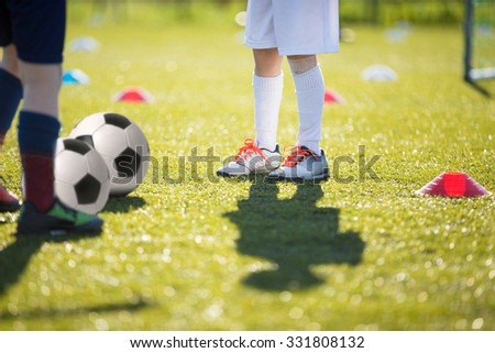 Ladder Drills Exercises for Football Soccer team. Physical education classes. Young player exercises on ladder drills - stock photo