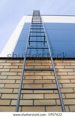 Ladder in the sky. The ladder for evacuation at a fire conducts on a roof