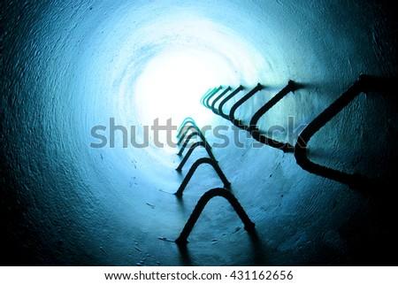 Ladder inside a maintenance tunnel - stock photo