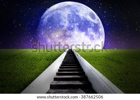 Ladder on grass field reach to the full moon in galaxy - stock photo
