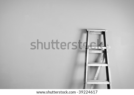 Ladder on the wall - stock photo