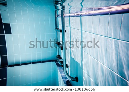 Ladder pool under water - stock photo