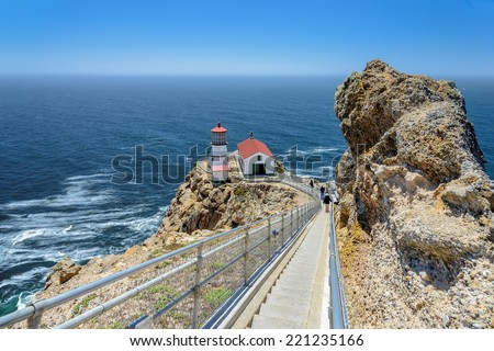 Ladder steps down to a lighthouse on the rock.  Point Reyes Lighthouse, San Francisco, California, USA - stock photo
