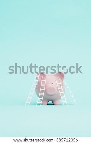 Ladders to climb onto a piggy bank. - stock photo