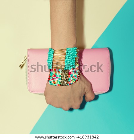 Ladies Accessories. Bracelets and Clutch. Fashion style Vanilla. - stock photo