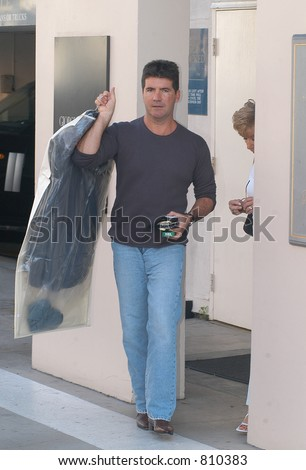 Ladies man Simon Cowell Has his hands full today with ex-girlfriend and girlfriend Teri  Seymour along with Simons mom Julie Cowell and goes shopping today - stock photo
