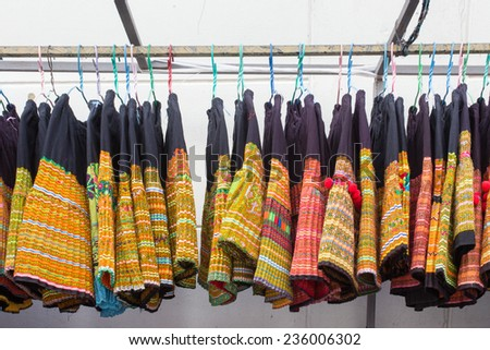 ladies skirt hung up on a porch railing on hangers to sell, traditional tribes style in thailand