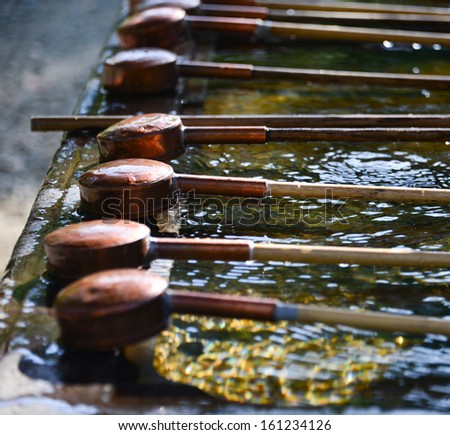 Ladle for water washing before entering the temple in Japan - stock photo