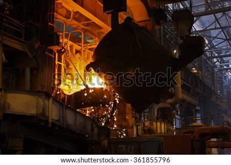 ladle of molten metal in the workshop of metallurgical plant