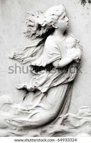 Lady and a child's tombstone - stock photo