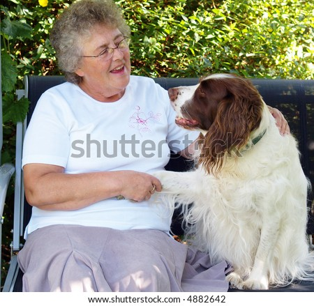 Lady and dog having a conversation about something? - stock photo