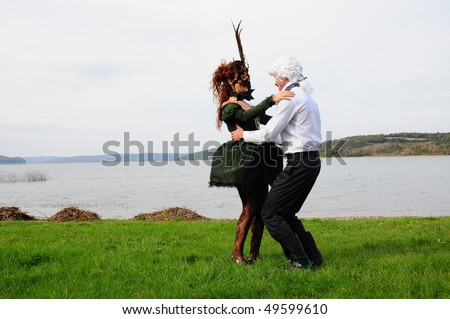lady and lord are dancing on green grass