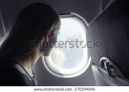 Lady and window - stock photo