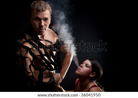 Lady blowing out smoke