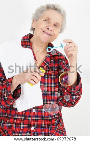 lady blowing soap bubbles - stock photo
