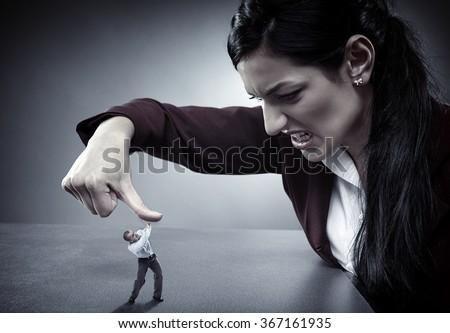 Lady Boss Crushing Employee Under Her Stock Photo ...