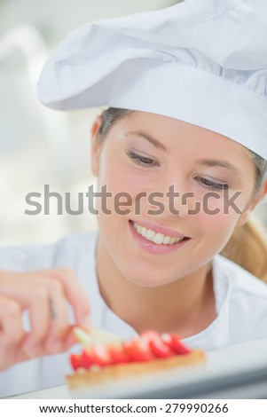 Lady chef at work - stock photo