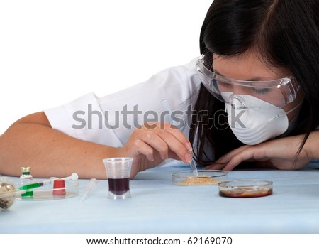 lady doctor or chemist in protective glasses and mask in laboratory; isolated over a white background