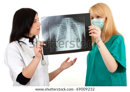lady doctors in uniforms looking at x-ray chest, lungs - stock photo