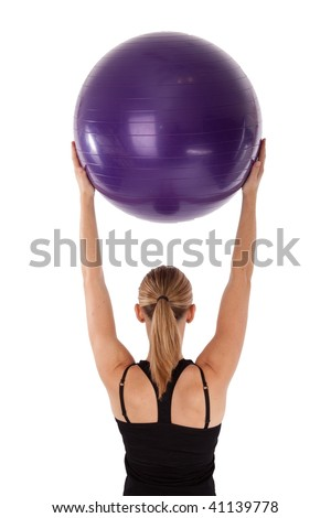 Lady doing yoga ball exercises isolated - stock photo