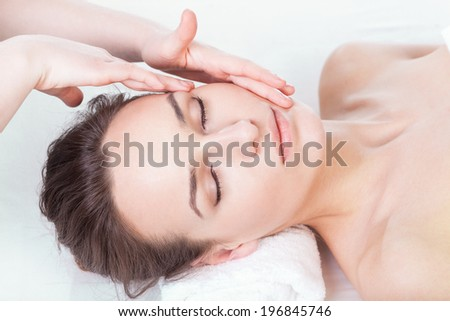 Lady during face massage in spa, horizontal
