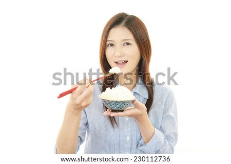 Lady eats food - stock photo
