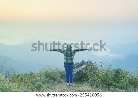 Lady enjoy with sun in the sunshine glow - stock photo